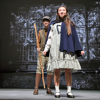 Two Exeter students in a performance of The Secret Garden