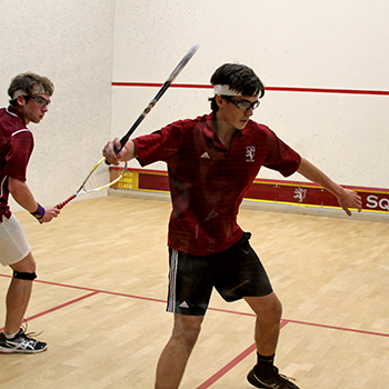 Students practicing inside Fisher Squash Center