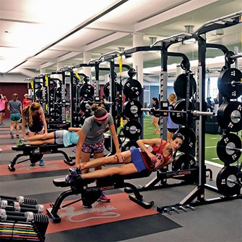 Students exercising in the Downer Family Fitness Center