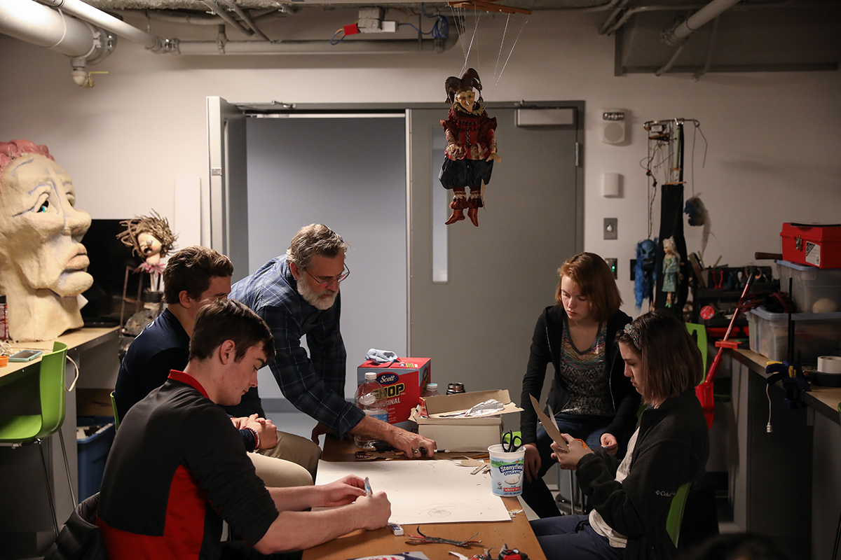 Rob Richards working with students in puppetry class.
