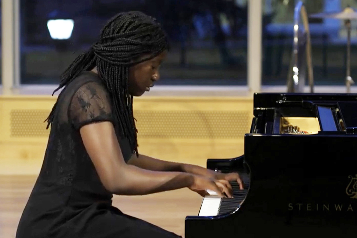 Exeter student Kiesse Nanor performing a song on the piano