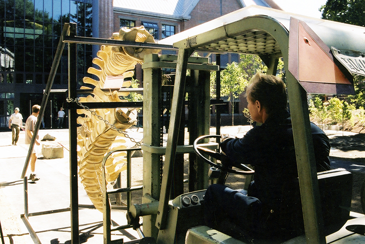 A worker uses a forklift to move the whale's skeleton into the Phelps Science Center