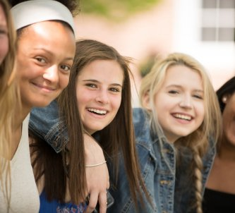 Five Exeter students smiling at the camera