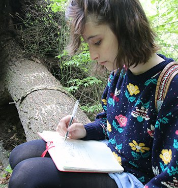 Senior Studies Student writing in a journal