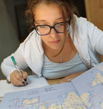 Student looking at a map