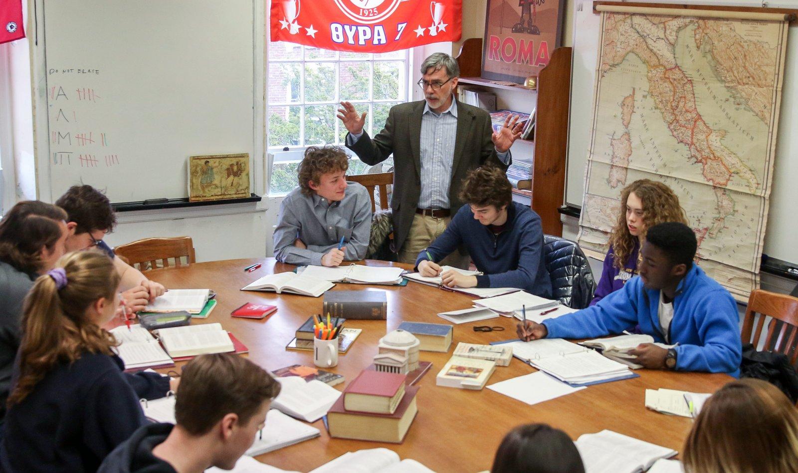 Matt Hartnett teaching around a Harkness table at Phillips Exeter Academy
