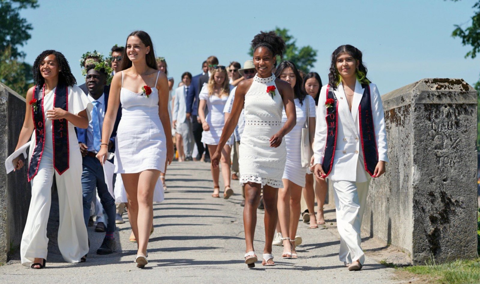 Marshals escort students to their seat at Exeter graduation