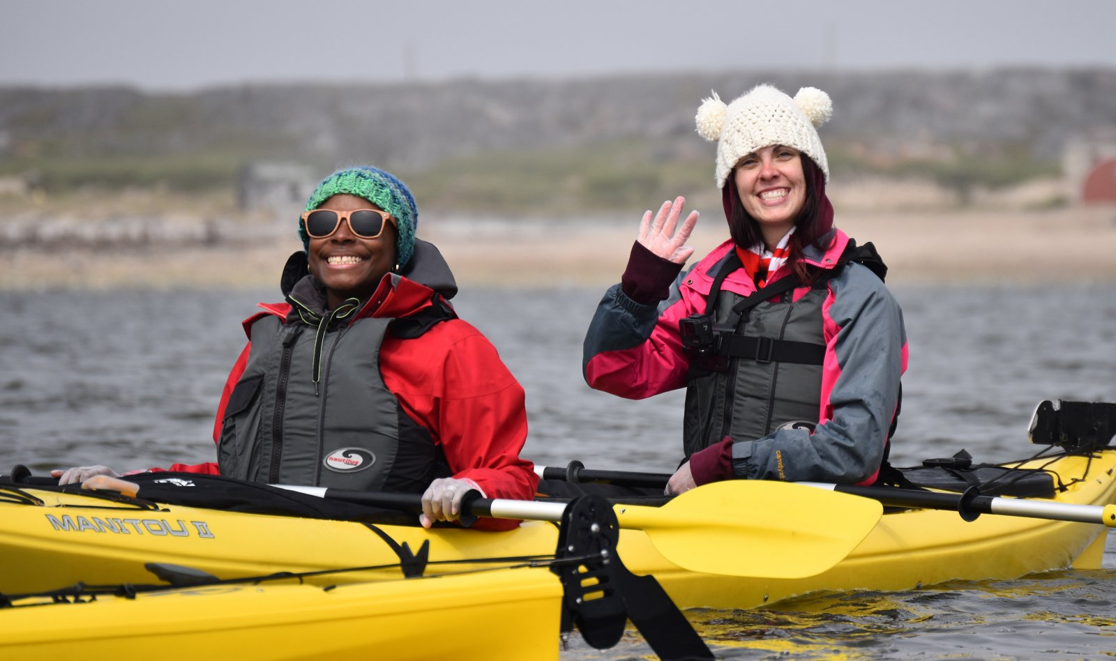 Kadeine Peterson (left), an instructor of science at Phillips Exeter Academy, paddles in Hudson Bay.
