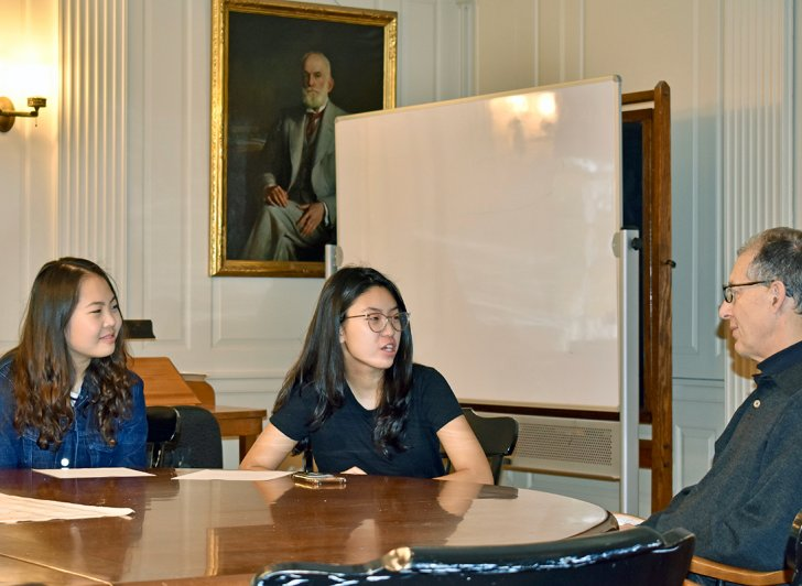 Suan Lee and Angele Yang seated next to Dr. James Romm
