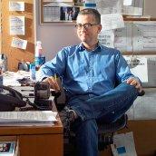Greg Daniels sitting in his office