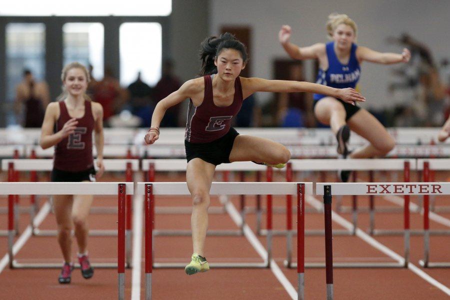 Evie Houston running hurdles.
