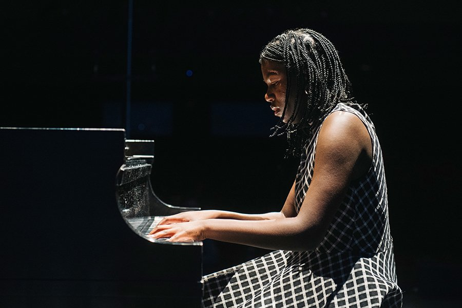 Kiesse Nanor playing piano