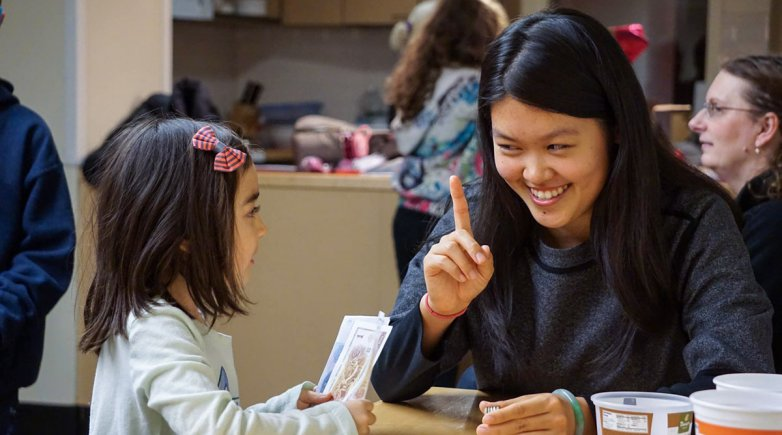 Jessica Zhao talking with a child.