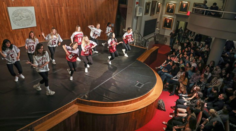 Students dancing on Assembly Hall stage at Phillips Exeter Academy.