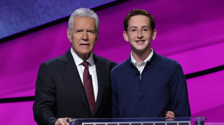 Caleb Richmond '21 with host Jeopardy! host Alex Trebek