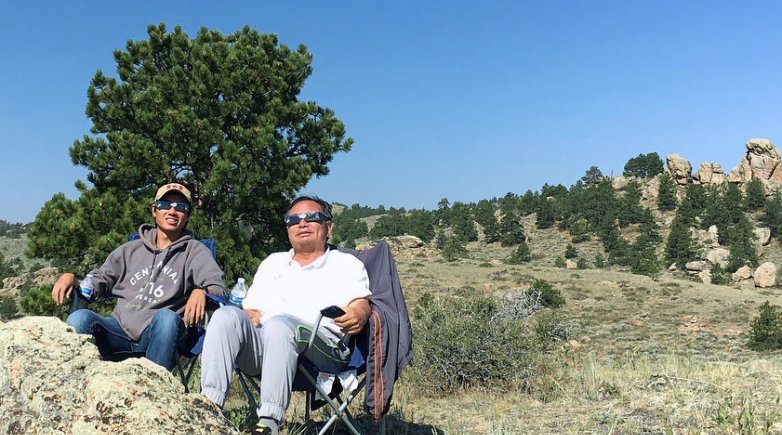 Brandon Liu and his dad get ready to watch the eclipse