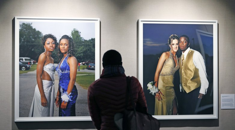 A visitor views Gillian Laub's photographs on display at the Lamont Gallery.