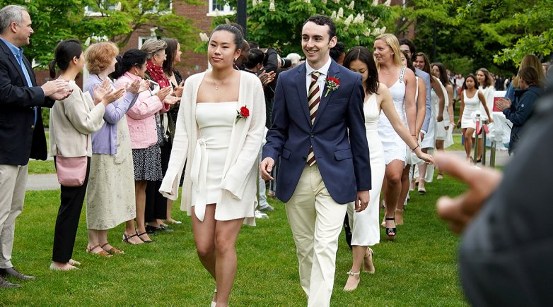 Class Marshal Bryce Morales leads classmates to chairs at the Phillips Exeter Academy graduation.