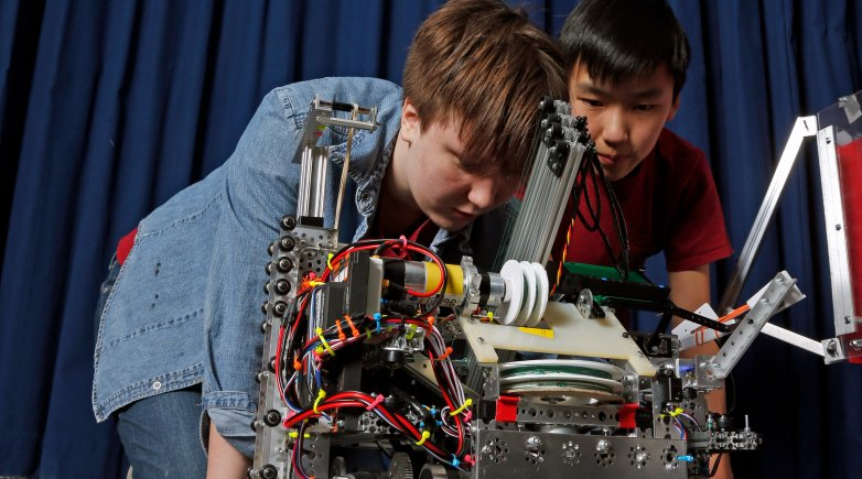 VERTEX team members work on the robot in the Design Lab.