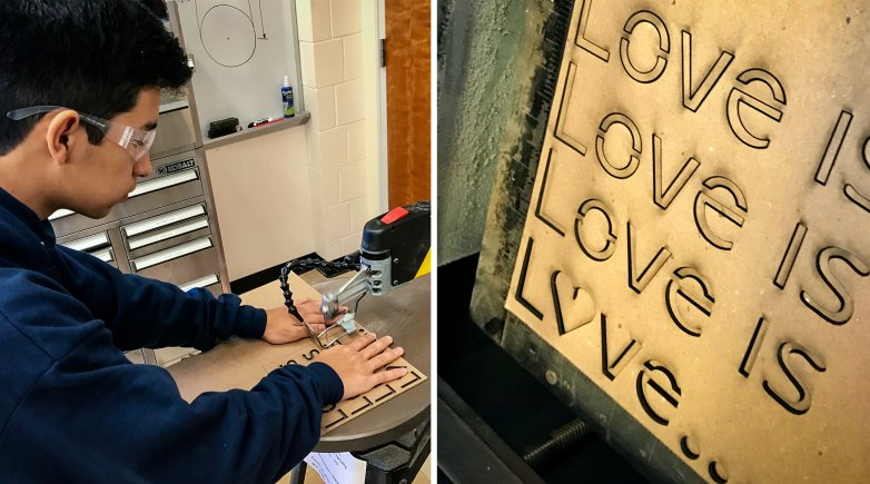 Boy using the laser cutter.