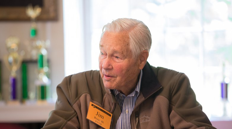 Jim Rose seated at a table during an Exeter reunion.