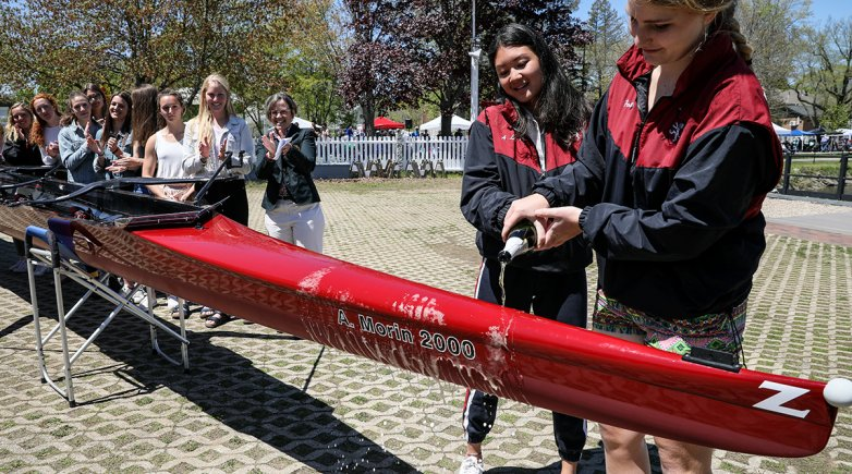 Exeter Varsity crew captains christening the A. Morin shell named for an Exeter alum