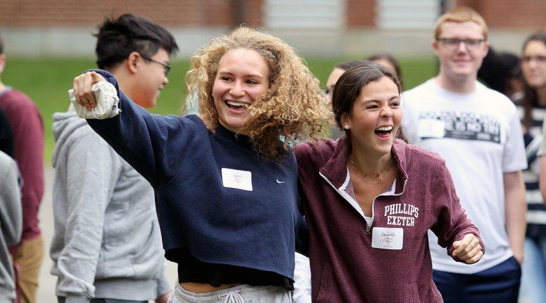 Exonians embrace during opening days