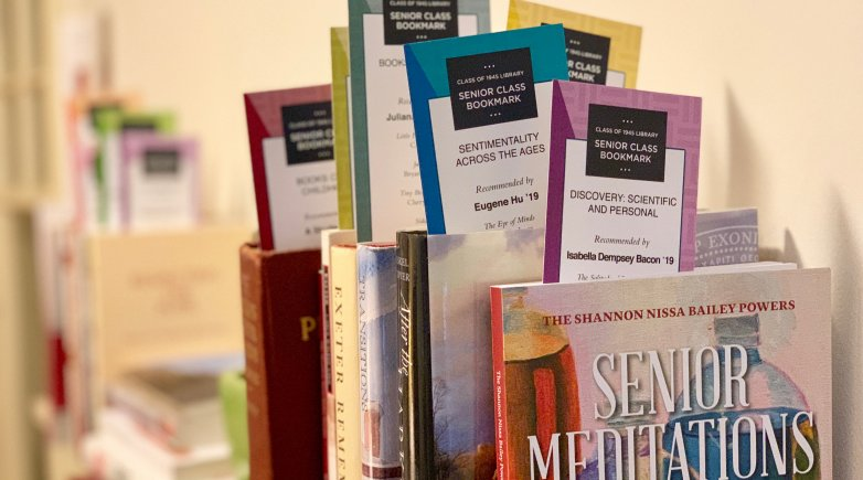 Books sporting senior bookmarks on display at the Phillips Exeter Library.