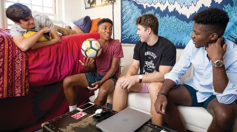 Exeter students hang out in a dorm room