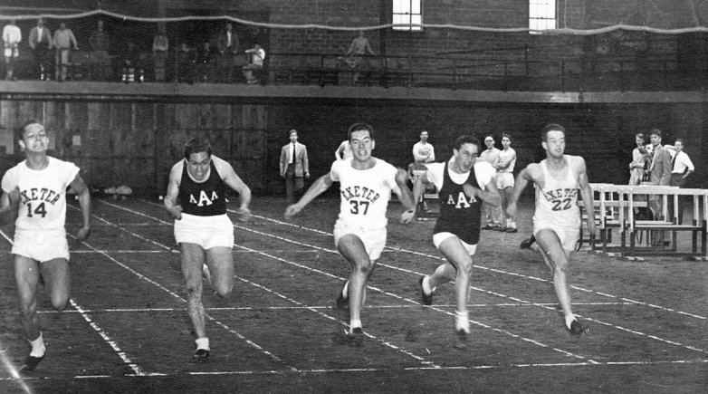 Exeter and Andover sprinters from 1952 competing in an indoor track meet