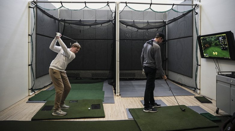 Members of the golf team practicing