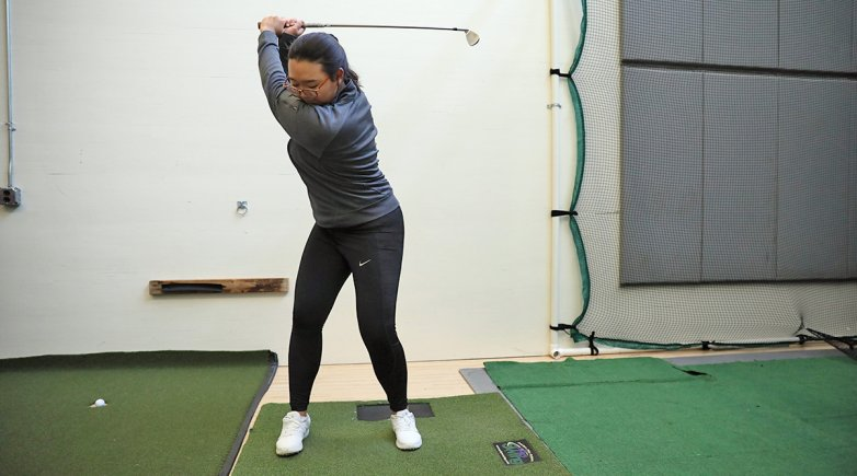 Eunice Kim practicing golf