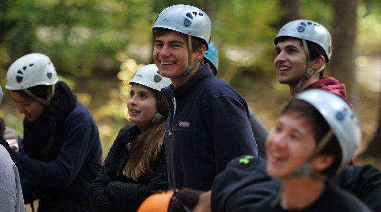 A group of Exeter student listeners at a ropes course