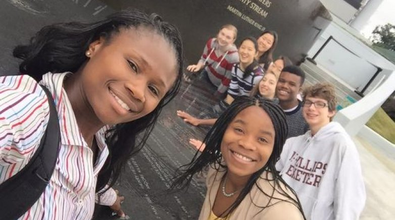 Exeter Physical Education Instructor Olutoyin Augustus-Ikwuakor with students at the Civil Rights Memorial in Montgomery Alabama