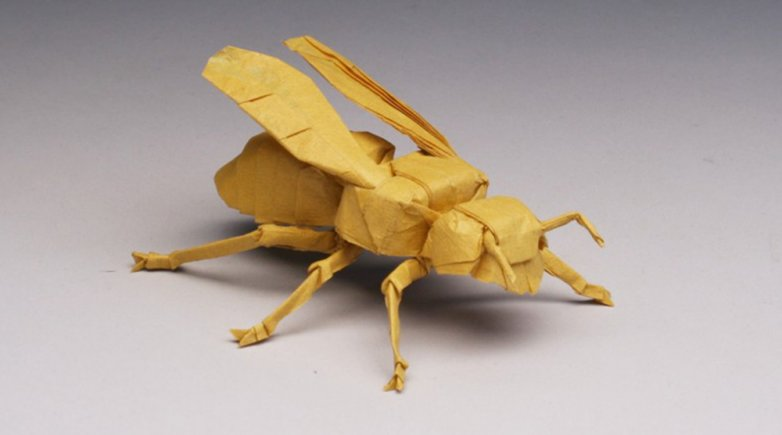 origami sculpture of a yellow jacket