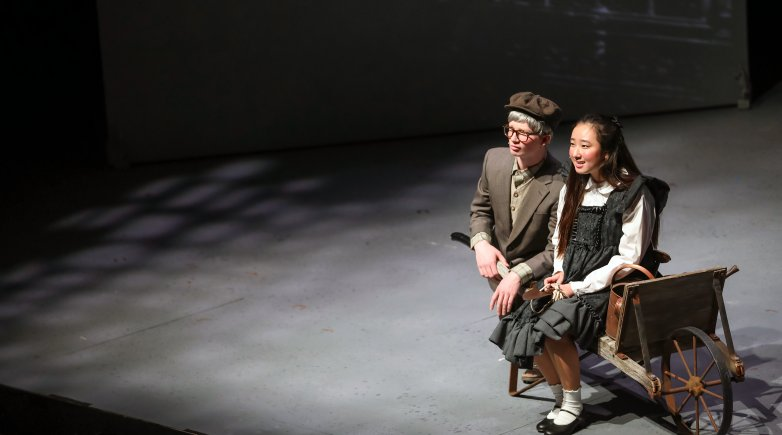 Two actors perform a scene from The Secret Garden.