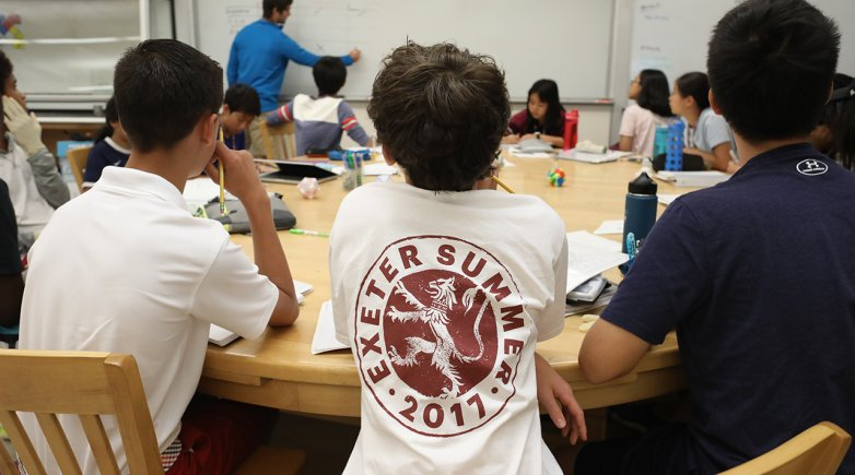 Exeter summer students sitting around a harkness table during math class