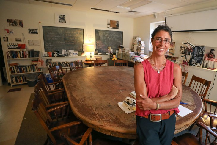 Instructor Mercy Carbonell stands in her classroom