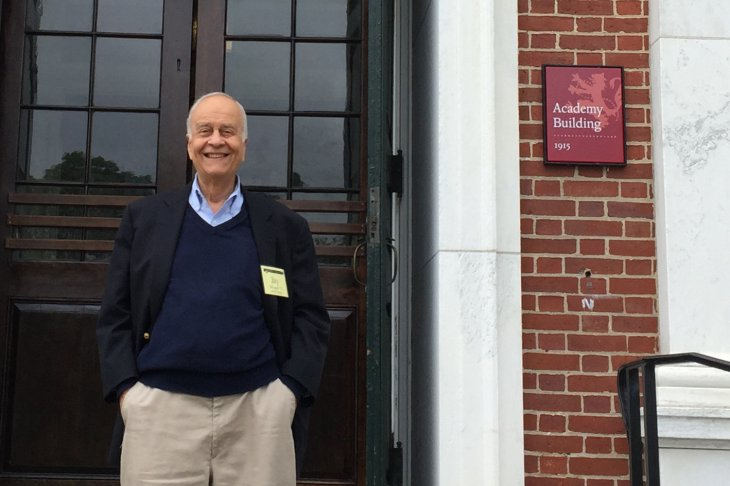 Jay N. Whipple Jr. stands in front of the Academy Building at Exeter
